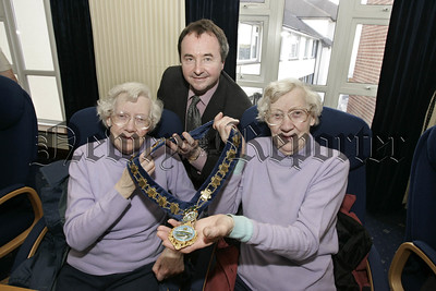 75year old (Birthday on Saturday last) twins Kathleen and Mary Boyle from Dromantee pictured with Mayor Pat Mc Ginn when the Forkhill Senior Citzens group visited  the Council Chamber on Tuesday last. 06W8N12