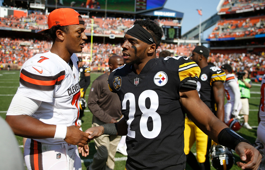 . Cleveland Browns quarterback DeShone Kizer (7) greets Pittsburgh Steelers strong safety Sean Davis (28) after an NFL football game, Sunday, Sept. 10, 2017, in Cleveland. (AP Photo/Ron Schwane)