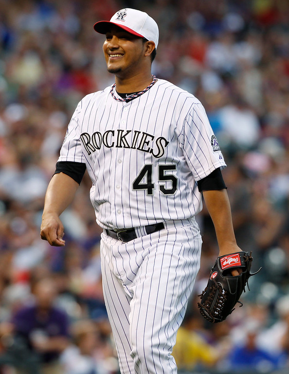 . Colorado Rockies starting pitcher Jhoulys Chacin smiles after retiring the Los Angeles Dodgers in the fourth inning of a baseball game in Denver, Thursday, July 4, 2013. (AP Photo/David Zalubowski)