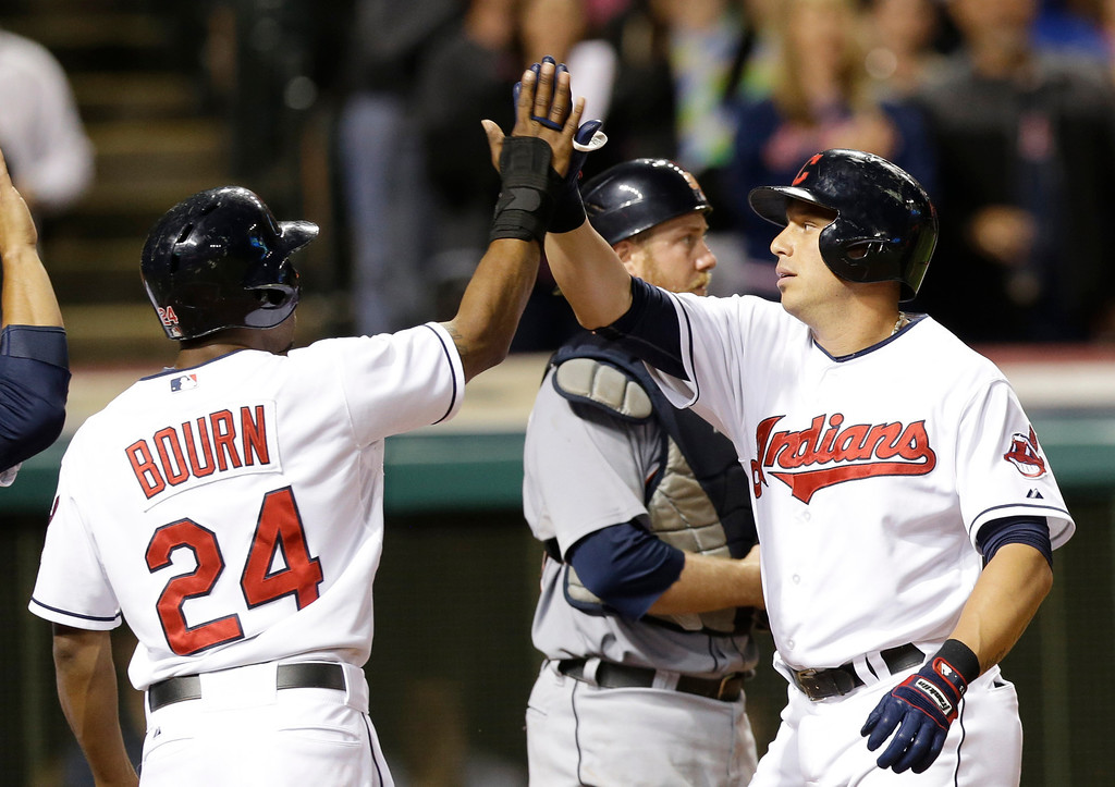 . Cleveland Indians\' Asdrubal Cabrera, right, is congratulated by teammate Michael Bourn after hitting a three-run home run off Detroit Tigers relief pitcher Ian Krol in the eighth inning of a baseball game on Friday, June 20, 2014, in Cleveland. Bourn and Mike Aviles also scored on the hit. (AP Photo/Tony Dejak)