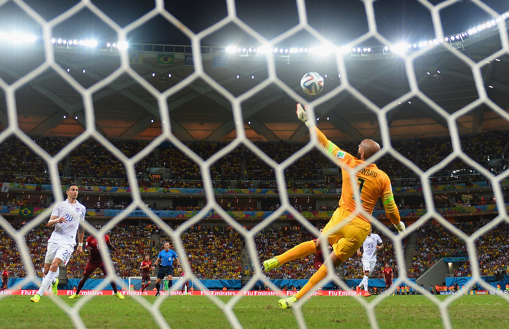 . Tim Howard of the United States makes a save on a shot by Eder of Portugal during the 2014 FIFA World Cup Brazil Group G match between the United States and Portugal at Arena Amazonia on June 22, 2014 in Manaus, Brazil.  (Photo by Christopher Lee/Getty Images)