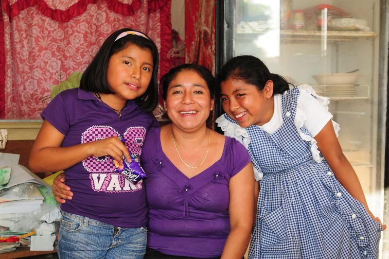 This microfinance partner takes a break from work to enjoy time with her two daughters.