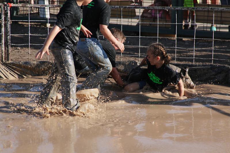 Havre Daily News / Floyd Brandt  Pig Wrestling at Blain County Fair Sunday team Muddie Buddies