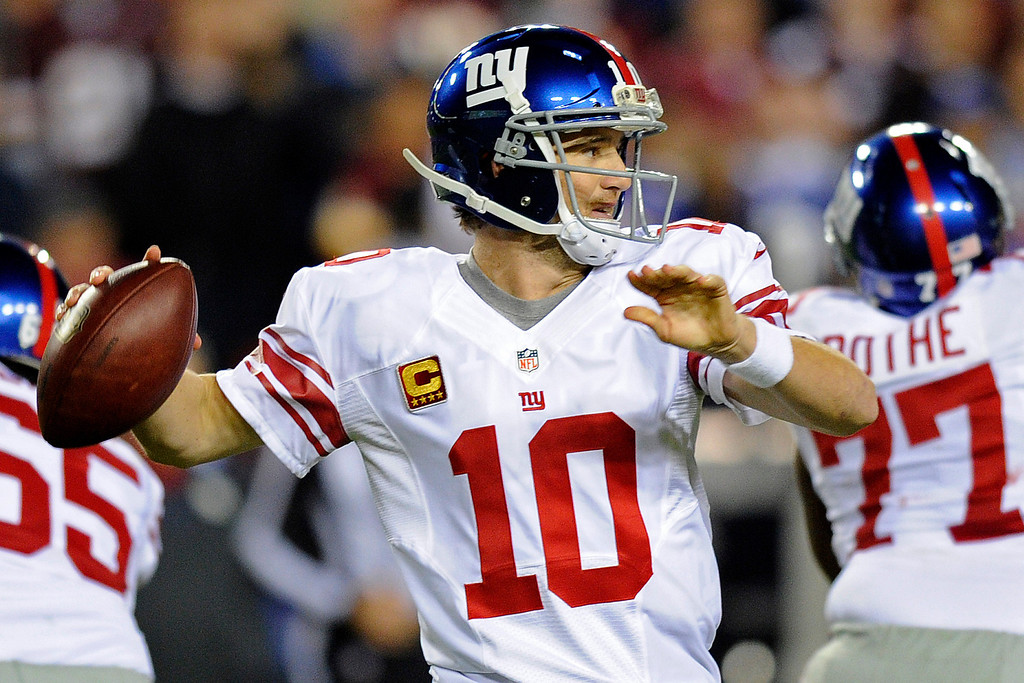 . New York Giants quarterback Eli Manning (10) passes the ball during the first half of an NFL football game against the Washington Redskins in Landover, Md., Monday, Dec. 3, 2012. (AP Photo/Nick Wass)
