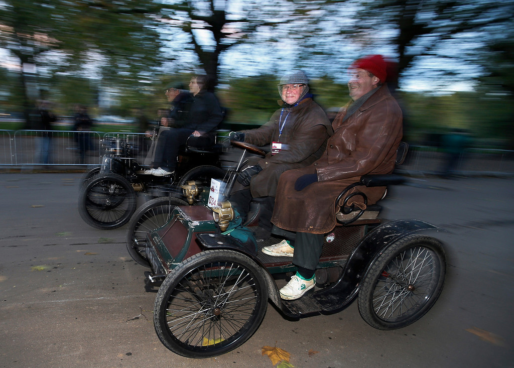. Participants drive their 1900 Clement car at the start line in London\'s Hyde Park, during the London to Brighton Veteran Car Run, Sunday, Nov. 3, 2013. Over 400 pre-1905 vehicles made their way on the historic 60-mile run from Hyde Park in London to coastal Brighton in southern England, in the world\'s longest running motoring celebration spanning 117 years. (AP Photo/Lefteris Pitarakis)