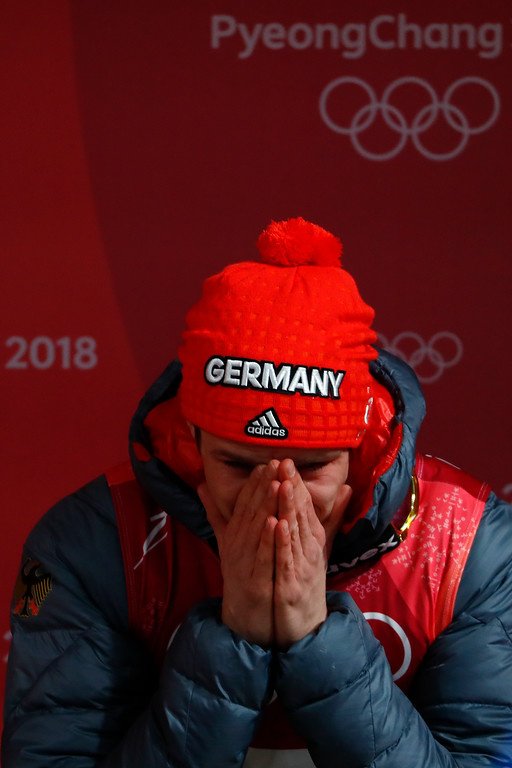 . Andreas Wellinger, of Germany, covers his face as he waits for the results to win the gold medal in the men\'s normal hill individual ski jumping competition at the 2018 Winter Olympics in Pyeongchang, South Korea, Sunday, Feb. 11, 2018. (AP Photo/Matthias Schrader)