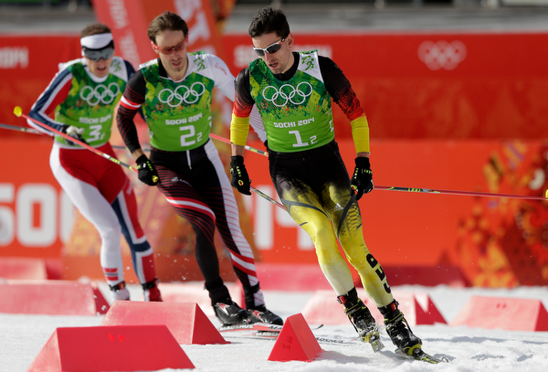 . Norway\'s Haavard Klemetsen, Austria\'s Christoph Bieler and Germany\'s Bjoern Kircheisen compete during the cross-country portion of the Nordic combined Gundersen large hill team competition at the 2014 Winter Olympics, Thursday, Feb. 20, 2014, in Krasnaya Polyana, Russia. (AP Photo/Matthias Schrader)