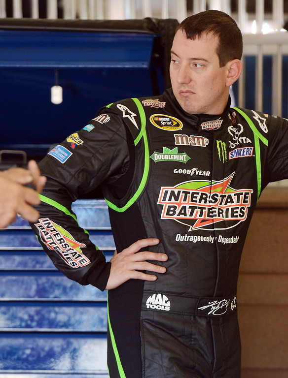 . (Will Lester/Staff Photographer) NASCAR driver Kyle Busch waits in the garage for his car to be prepared during the opening practice session for Sunday\'s Auto Club 400 Friday March 22, 2013.