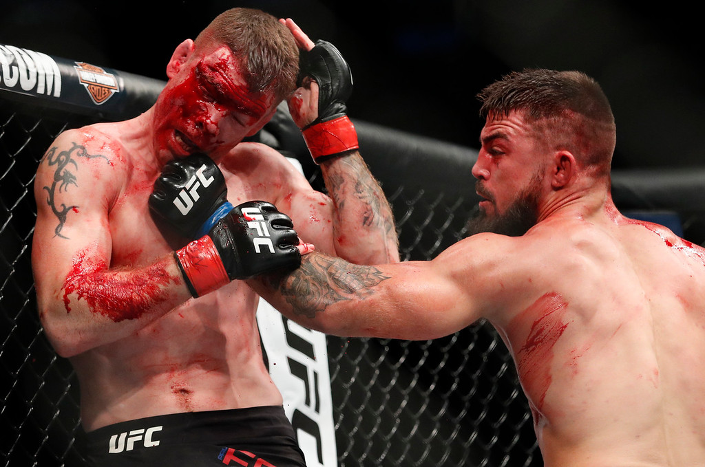 . Mike Perry, right, hits Paul Felder during a welterweight mixed martial arts bout at UFC 226, Saturday, July 7, 2018, in Las Vegas. (AP Photo/John Locher)