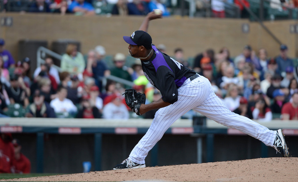 . SCOTTSDALE, AZ. - FEBRUARY 24: Juan Nicasio (44) of the Colorado Rockies delivers a pitch in the fourth inning against the Arizona Diamondbacks February 24, 2013 in Scottsdale. (Photo By John Leyba/The Denver Post)