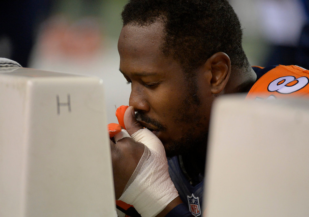 . Denver Broncos outside linebacker Von Miller (58) prays before the start of the game. The Denver Broncos take on the Kansas City Chiefs at Sports Authority Field at Mile High in Denver on November 17, 2013. (Photo by John Leyba/The Denver Post)