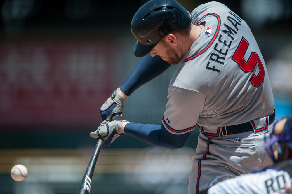 . Freddie Freeman #5 of the Atlanta Braves puts a ball in play and grounds out against the Colorado Rockies in the first inning of a game at Coors Field on June 12, 2014 in Denver, Colorado.  The game was tied with no score after one inning. (Photo by Dustin Bradford/Getty Images)