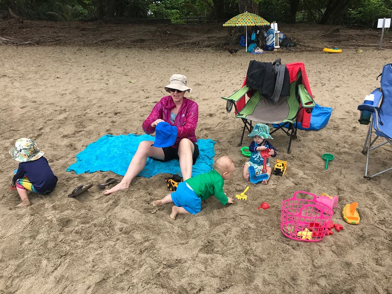 Finn, Leif and Asher playing by Grandma Mitzi while their parents hike the Kalalau Trail