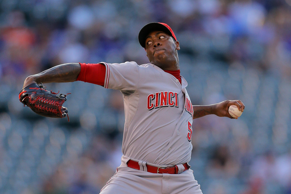 . Relief pitcher Aroldis Chapman #54 of the Cincinnati Reds delivers to home plate during the ninth inning against the Colorado Rockies at Coors Field on August 17, 2014 in Denver, Colorado. The Rockies defeated the Reds 10-9. (Photo by Justin Edmonds/Getty Images)