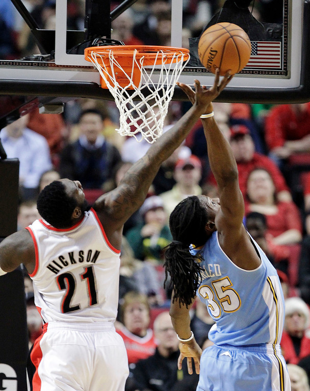 . Portland Trail Blazers center J.J. Hickson (21) and Denver Nuggets forward Kenneth Faried battle for a rebound during the first quarter of an NBA basketball game in Portland, Ore., Wednesday, Feb. 27, 2013. (AP Photo/Don Ryan)