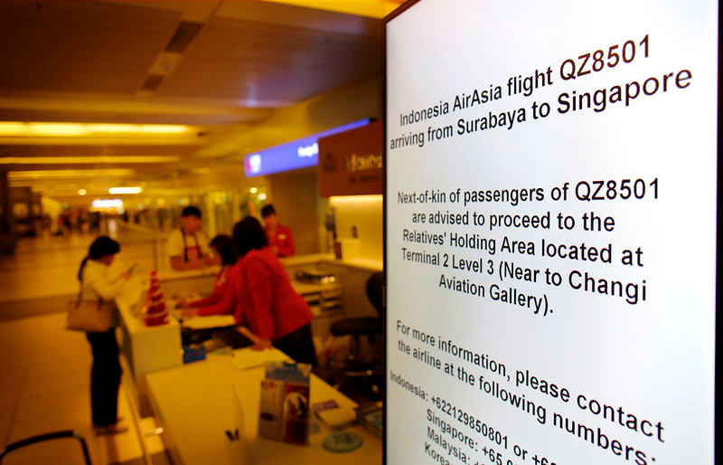 . Electronic sign boards instructing relatives and next-of-kin to gather at a holding area are placed in various places at the Changi International Airport where AirAsia flight QZ8501 from Surabaya was scheduled to land, Sunday, Dec. 28, 2014 in Singapore. An AirAsia plane with 162 people on board lost contact with ground control on Sunday while flying over the Java Sea after taking off from a provincial city in Indonesia for Singapore. The two countries immediately launched a search and rescue operation but there was no word on the plane\'s whereabouts more than six hours after it went missing. (AP Photo/Wong Maye-E)