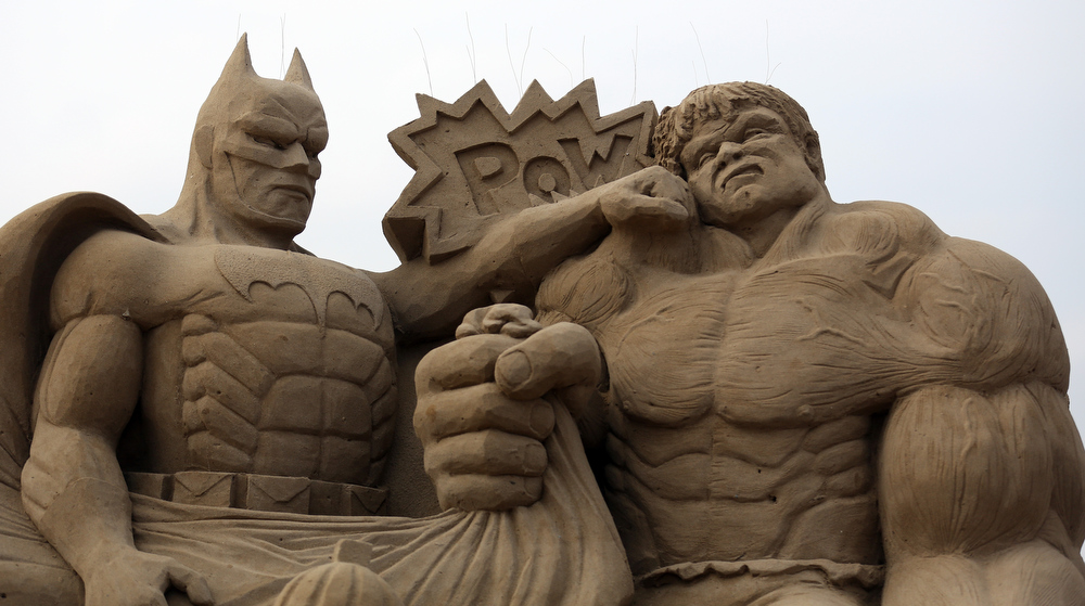 Description of . Detail of a sand sculpture of Batman and The Incredible Hulk is seen as pieces are prepared as part of this year's Hollywood themed annual Weston-super-Mare Sand Sculpture festival on March 26, 2013 in Weston-Super-Mare, England. Due to open on Good Friday, currently twenty award winning sand sculptors from across the globe are working to create sand sculptures including Harry Potter, Marilyn Monroe and characters from the Star Wars films as part of the town's very own movie themed festival on the beach.  (Photo by Matt Cardy/Getty Images)