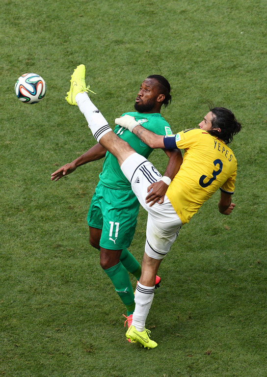 . Didier Drogba of the Ivory Coast competes for the ball with Mario Yepes of Colombia during the 2014 FIFA World Cup Brazil Group C match between Colombia and Cote D\'Ivoire at Estadio Nacional on June 19, 2014 in Brasilia, Brazil.  (Photo by Adam Pretty/Getty Images)