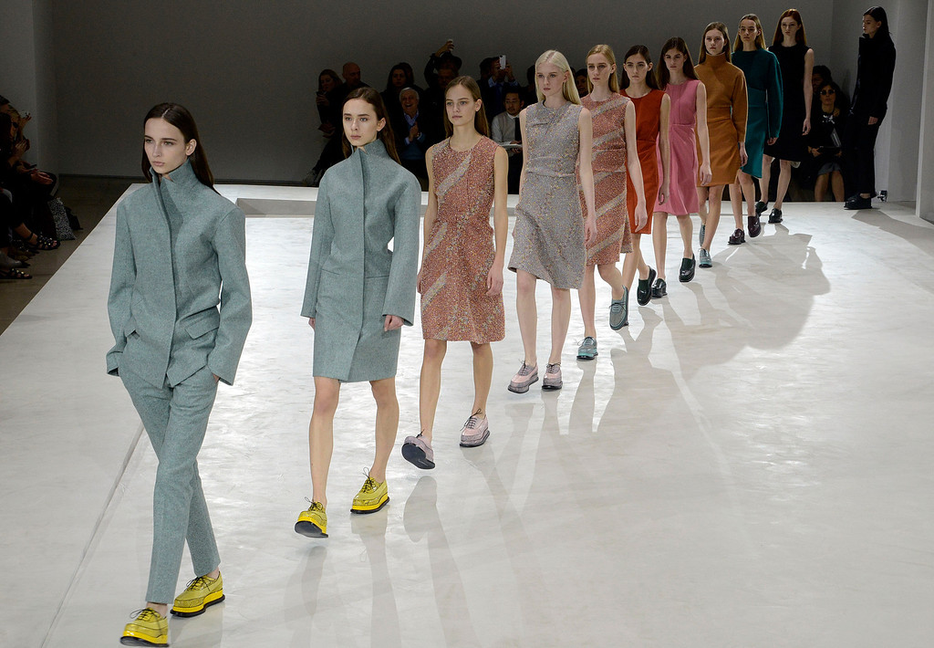 . Models wear creations for Jil Sander women\'s Fall-Winter 2014-15 collection, part of the Milan Fashion Week, unveiled in Milan, Italy, Friday, Feb. 21, 2014. (AP Photo/Giuseppe Aresu)