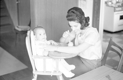 Martha feeding David in his highchair at our house in Higashi-Tamagawa, Tokyo. 1965