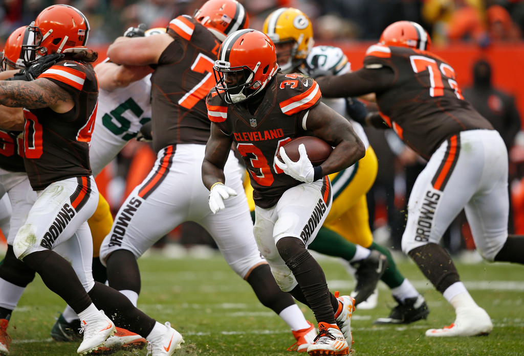 . Cleveland Browns running back Isaiah Crowell (34) runs the ball against the Green Bay Packers in the second half of an NFL football game, Sunday, Dec. 10, 2017, in Cleveland. (AP Photo/Ron Schwane)