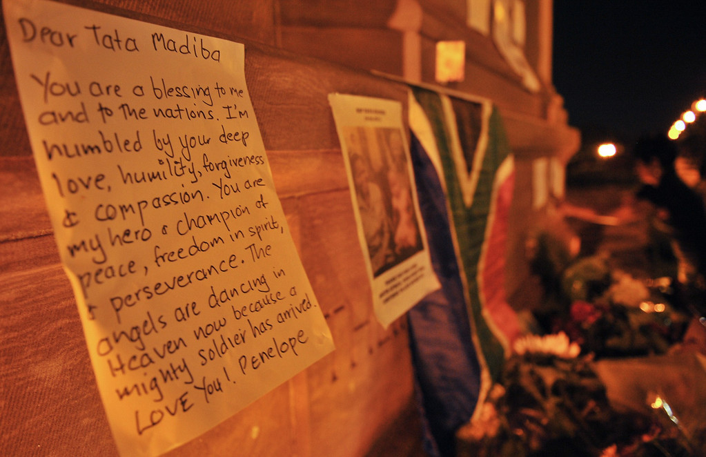 . A condolence message is left by a mourner  in remembrance of the late former South African President Nelson Mandela outside the Union Buildings, in Pretoria, South Africa, on December 6, 2013. Mandela died aged 95 at his Johannesburg home on December 5, 2013 after a prolonged lung infection. AFP PHOTO / Phill Magakoe/AFP/Getty Images