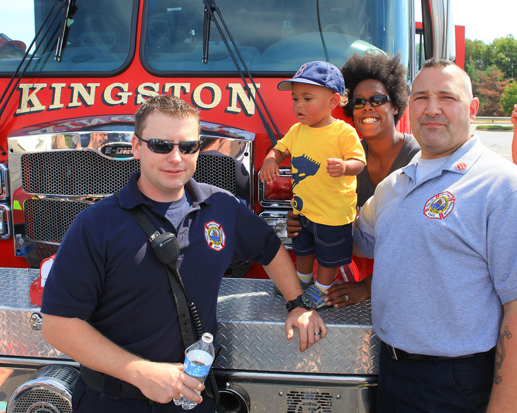 Kingston Firefighters Chris Ebert, left, and Dave Binari pose with 14 month old Colton Craffey and his Mom Satina at Saturday's Touch A Truck event to raise funds for the Wounded Warrior Project. Wicked Local Photo/Denise Maccaferri