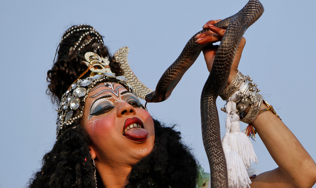 . A devotee dressed as Hindu God Shiva participates in a procession on the eve of Shivratri festival, in Jammu, India, Wednesday, Feb. 26, 2014. (AP Photo/Channi Anand)