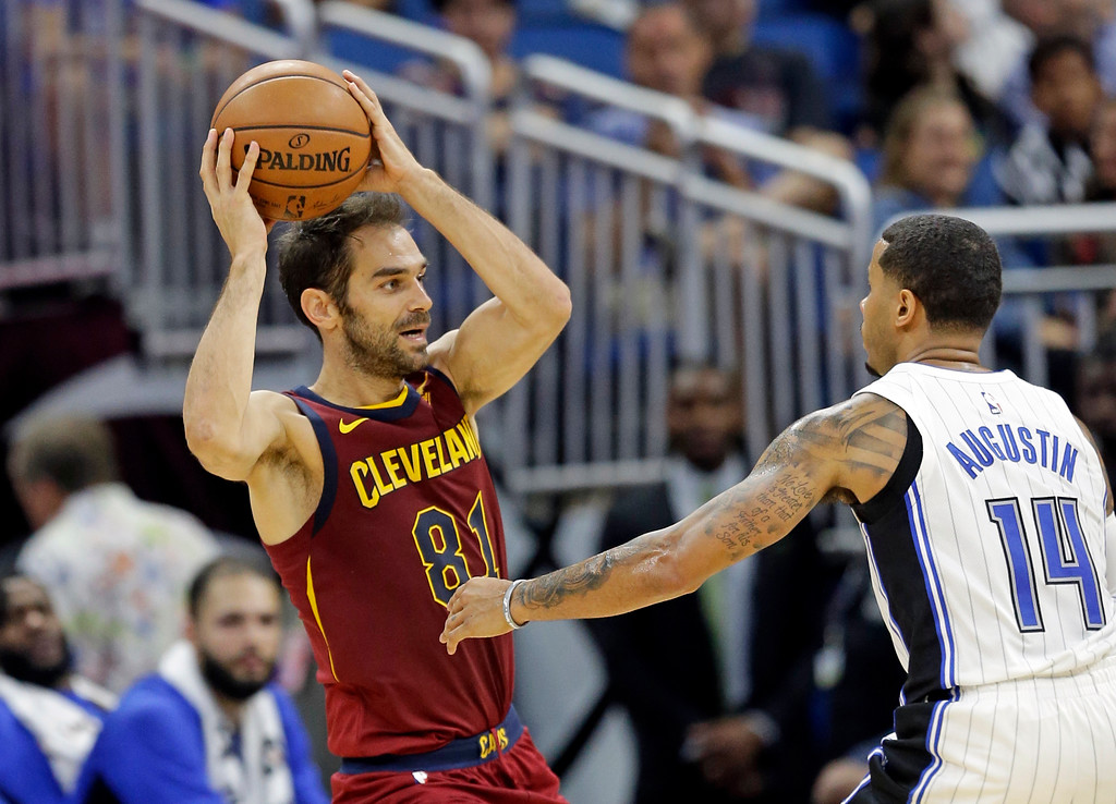 . Cleveland Cavaliers\' Jose Calderon (81) passes the ball over Orlando Magic\'s D.J. Augustin (14) during the second half of an NBA preseason basketball game, Friday, Oct. 13, 2017, in Orlando, Fla. Cleveland won 113-106. (AP Photo/John Raoux)