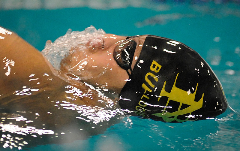 North Bend's Logan Lampe competes in the men's 100-yard backstroke during the 26th annual North Bend swimming invitational at the North Bend Municipal Pool in North Bend, Ore. on Saturday, Dec. 9, 2017.