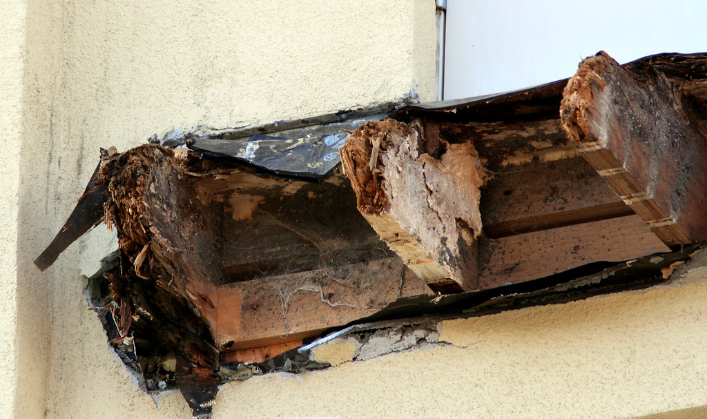 . The rotted wood beams that held the balcony jut out from side of the residential apartment building on Kittredge Street in Berkeley, Calif. on Wednesday, June 17, 2015.  Six people died and seven others were seriously injured when the balcony collapsed early Tuesday morning during a birthday party. (Laura A. Oda/Bay Area News Group)