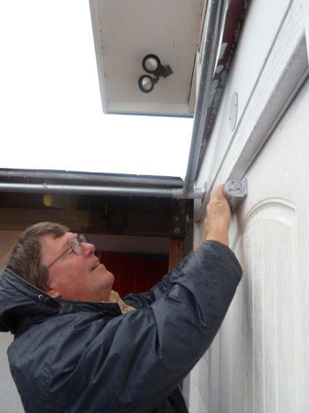 Clark installing door closer.jpg