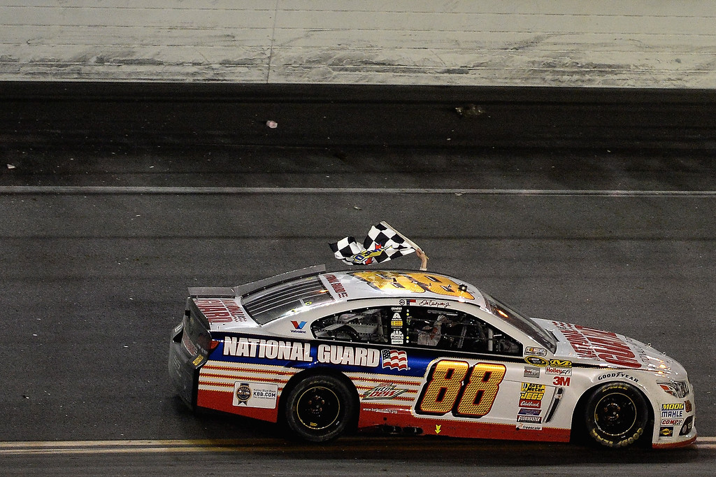 . Dale Earnhardt Jr., driver of the #88 National Guard Chevrolet, celebrates with the checkered flag after winning the NASCAR Sprint Cup Series Daytona 500 at Daytona International Speedway on February 23, 2014 in Daytona Beach, Florida.  (Photo by Patrick Smith/Getty Images)