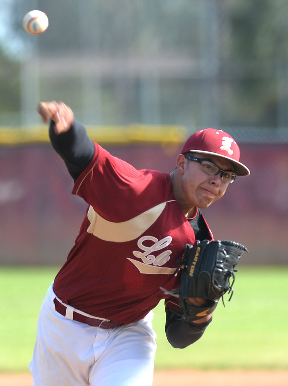 . La Serna\'s Enrique Pacheco (#6) makes a pitch as they play Santa Fe in their Del Rio League game at La Serna High School in Whittier on Wednesday April 23, 2014. (Staff Photo by Keith Durflinger/Whittier Daily News)