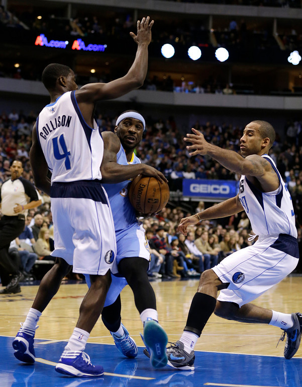 . Dallas Mavericks\' Darren Collison (4) and Dahntay Jones, right, defend as Denver Nuggets point guard Ty Lawson looks for an opening to the basket in the first half of an NBA basketball game on Friday, Dec. 28, 2012, in Dallas. (AP Photo/Tony Gutierrez)