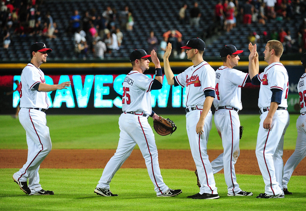 . Members of the Atlanta Braves celebrate after the game against the Colorado Rockies at Turner Field on July 31, 2013 in Atlanta, Georgia. (Photo by Scott Cunningham/Getty Images)