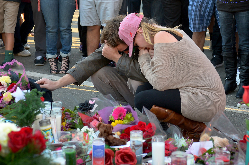. A couple grieves at a memorial for Paul Walker and Roger Rodas, Sunday, December 1, 2013, at the scene of their fatal crash site on Hercules Street near Kelly Johnson Parkway in Valencia. (Photo by Michael Owen Baker/L.A. Daily News)