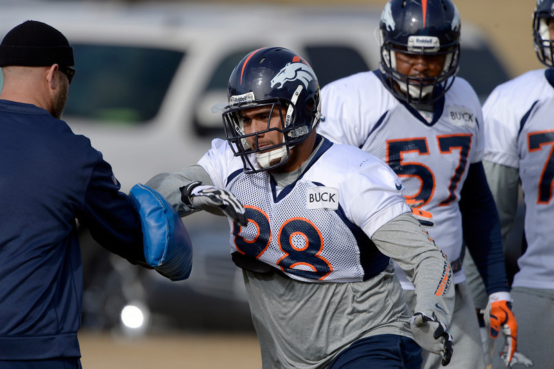. Denver Broncos offensive guard Sione Fua (98) runs through drills during practice January 16, 2014 at Dove Valley. The Denver Broncos are preparing for their AFC Championship game against the New England Patriots at Sports Authority Field.  (Photo by John Leyba/The Denver Post)