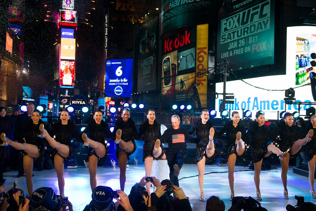 . New York Mayor Michael Bloomberg dances with the Radio City Rockettes in Times Square during New Year\'s celebrations on Tuesday, Jan. 1, 2013 in New York. (Photo by Charles Sykes/Invision/AP)