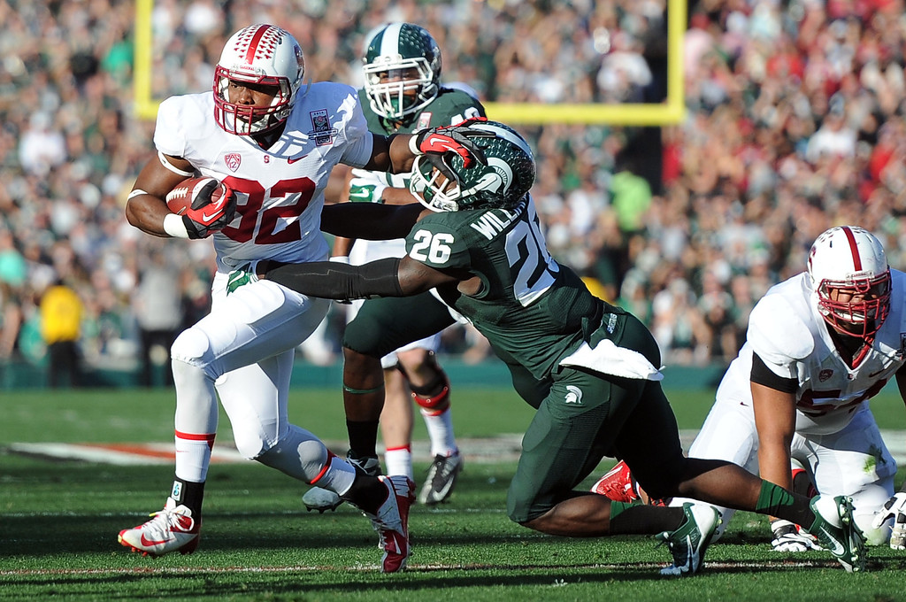 . Stanford\'s Anthony Wilkerson (32) catches a pass for a 7 yard first down as Michigan State\'s RJ Williamson (26) tries to tackle in the first half of the 100th Rose bowl game in Pasadena, Calif., on Wednesday, Jan.1, 2014.   (Keith Birmingham Pasadena Star-News)