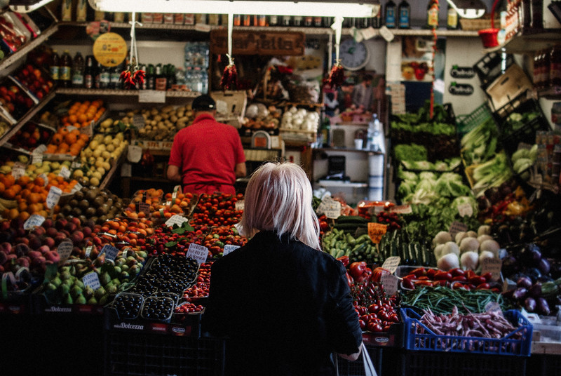 bolbogna-bounty-of-fruits-veggies-woman-standing-small-web.jpg