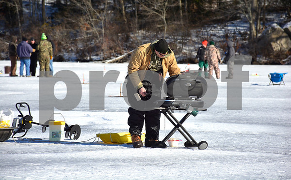 2/3/2018 MIke Orazzi | Staff Bill Wassik during the Terryville Fish & Game Club's annual ice fishing derby held on Middle Pond Saturday in Terryville.