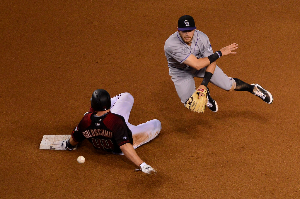 . Trevor Story #27 of the Colorado Rockies turns the double play over the sliding Paul Goldschmidt #44 of the Arizona Diamondbacks in the fourth inning at Chase Field on April 30, 2016 in Phoenix, Arizona.  (Photo by Jennifer Stewart/Getty Images)