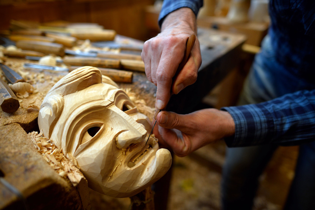 . Wood sculptor Adrian Burger chisels at a wooden mask that he is preparing for a client for Carnival, locally called Fastnacht or Fasnet, at his workshop on February 26, 2014 in Elzach, Germany. Burger produces about 120 masks a year for local revelers but also for collectors, and is one of four artisans in Elzach who have specialized in the masks in a local tradition going back to the 16th century. Carnival in the region is already underway and will continue through early next week in celebrations similar to shrovetide or Mardi Gras.  (Photo by Thomas Lohnes/Getty Images)