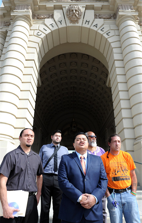 """. Attorney James Segall-Gutierrez, center, speaking to media at press conference regarding Civil Rights Violation lawsuit against Pasadena. City of Pasadena was served Civil Rights Complaint filed at the United States District Court Central District of California and served Thursday, February 27, 2014 in Pasadena after a press conference on the steps of City Hall.  Lilia Novelo, City Clerk\'s Office accepted the Civil Rights Complaint from attorney Jaime Segall-Gutierez. Felony charges have been dismissed against four of the \""""Foxy 6\"""" protesters, on a visit by Mexico President Vicente Fox in 2012.(Photo by Walt Mancini/Pasadena Star-News)"""