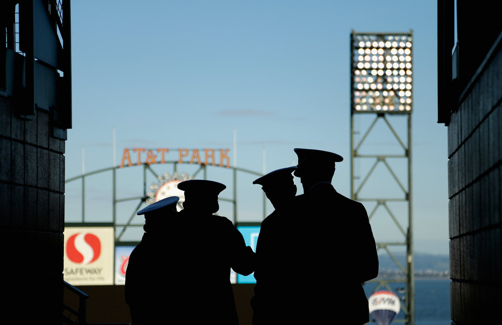 Description of . Members of the US Navy stand in the upper deck and watch the Kraft Fight Hunger Bowl between the Navy Midshipmen and the Arizona State Sun Devils at AT&T Park on December 29, 2012 in San Francisco, California.  (Photo by Ezra Shaw/Getty Images)