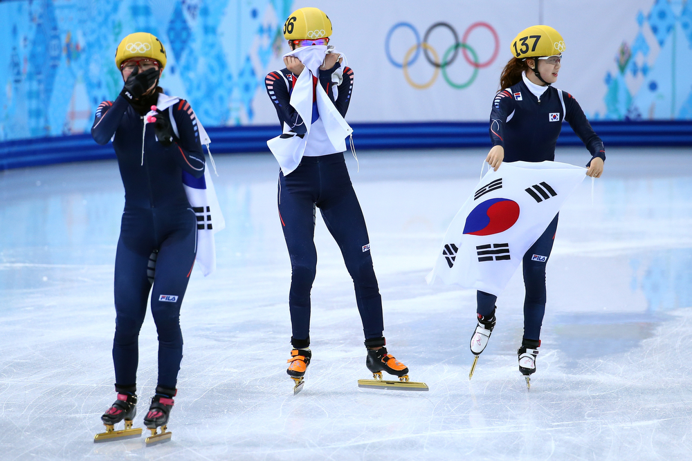 . Members of South Korean short track team celebrate winning the gold medal in the Short Track Ladies\' 3000m Relay Final at Iceberg Skating Palace on day 11 of the 2014 Sochi Winter Olympics on February 18, 2014 in Sochi, Russia.  (Photo by Streeter Lecka/Getty Images)