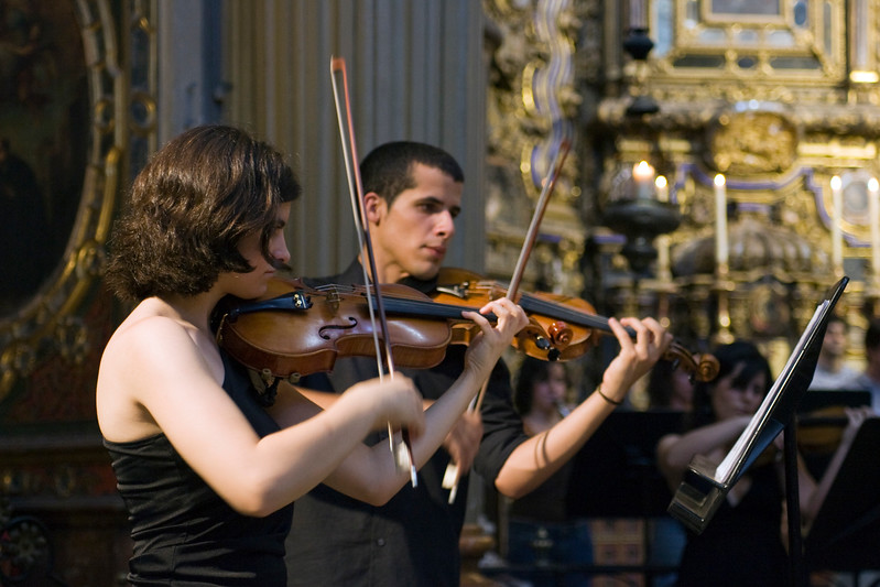 Young violinists playing in San Luis de los Franceses church, Seville, Spain