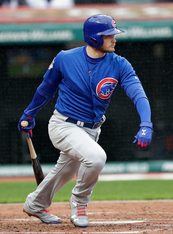 . Chicago Cubs\' Ian Happ watches his ball after hitting an RBI-single off Cleveland Indians starting pitcher Josh Tomlin in the second inning of a baseball game, Tuesday, April 24, 2018, in Cleveland. Addison Russell scored on the play. (AP Photo/Tony Dejak)