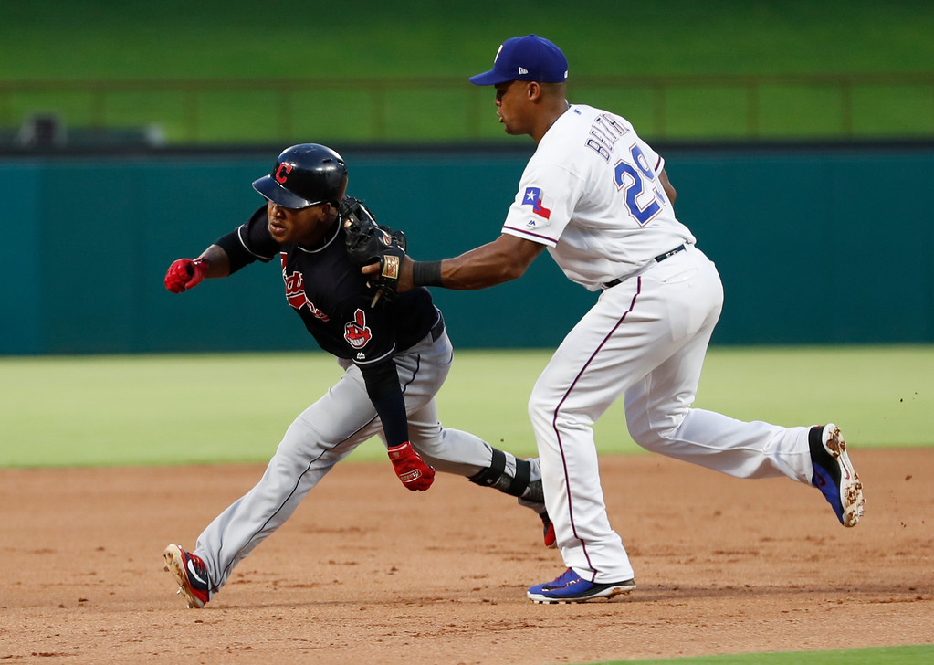 . Cleveland Indians\' Jose Ramirez, left, is tagged out by Texas Rangers third baseman Adrian Beltre (29) as Ramirez attempted to reach third after a single and a fielding error during the fifth inning of a baseball game, Saturday, July 21, 2018, in Arlington, Texas. (AP Photo/Jim Cowsert)